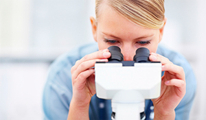 woman and microscope